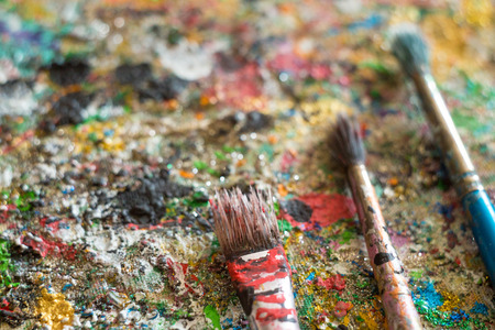 oil paints: oil paints and paint brushest, artistic. Stock Photo