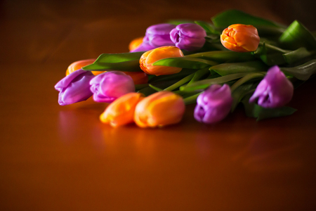 bouquet of colorful tulips on wooden board, easter decoration