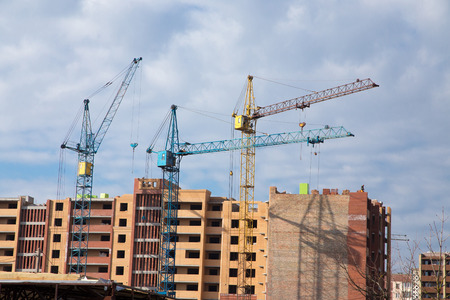 Construction site with cranes on sky background Imagens