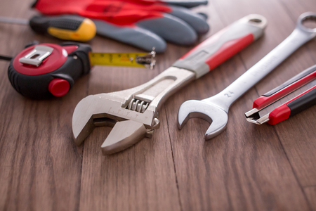 Working tools on wooden background Imagens