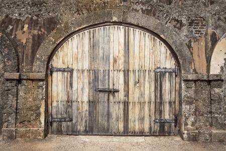 stud: Big wooden hall door in a rustic stud farm Stock Photo