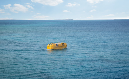 lifeboat: lifeboat on a sea