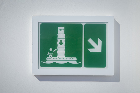 boat accident: Emergency exit sign on a cruise ship - safety on sea