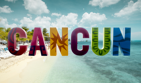 Colorful Cancun sign with beach in the background