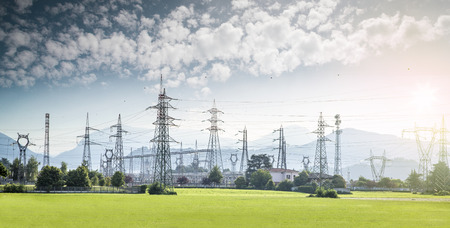 high voltage current: electricity towers and high voltage lines in a nice landscape