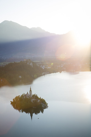 bird view: Bird view on Bled lake, its island with church and the castle on a rock, with Julian Alps in the background. Stock Photo