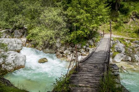 Old wooden bridge over Soca river, Slovenia