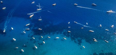Many yachts and boats on the sea near Capri Island, Italy
