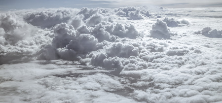 fluffy clouds: Panoramic aerial view above white fluffy clouds Stock Photo
