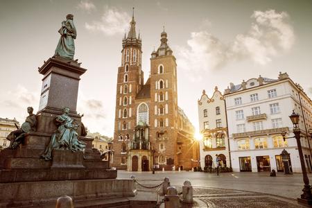 marys: St. Marys Basilica and Adam Mickiewicz monument on main square in Krakow, Poland