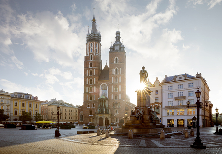 Panorama of old city center with Adam Mickiewicz monument and St. Marys Basilica in Krakow