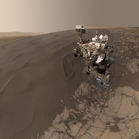 Curiosity rover exploring the surface of Mars