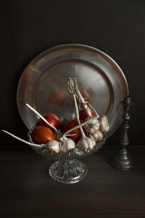 still life with garlic and tomatoes