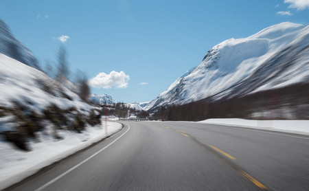 Mountain road at high speed with motion blur effect 版權商用圖片