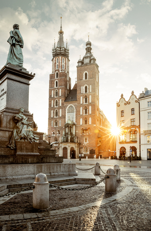 Adam Mickiewicz monument and St. Marys Basilica on Main Square in Krakow, Poland