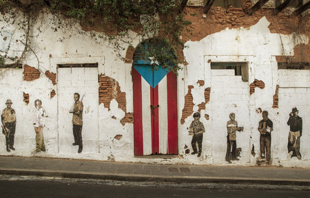 San Juan, Puerto Rico - June 25, 2015: Graffiti and puerto rican flag painted on the door in Old San Juan, Puerto Rico