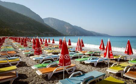 Oludeniz, Turkey - August 14, 2017: Beach with colorful sunbeds in Oludeniz, Turkey