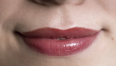 Big, full, natural lips of a woman - macro photography