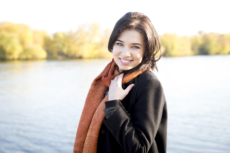 Attractive young girl in a park in autumn Stock fotó