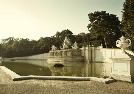 Vienna, Austria - August 03, 2014: Fountain in the garden of Schonbrunn palace in Vienna, Austria Редакционное
