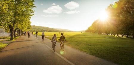Krakow, Poland - May 18, 2017: People cycling around Blonia meadow in Krakow, Poland Foto de archivo - 128140319