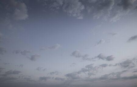 Night sky with fluffy clouds Фото со стока