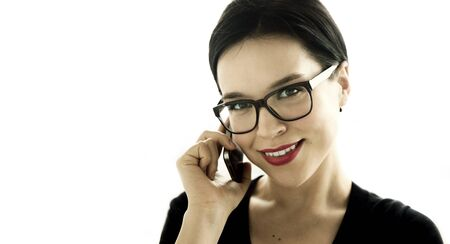 Young attractive woman speaking by phone Foto de archivo - 128741018