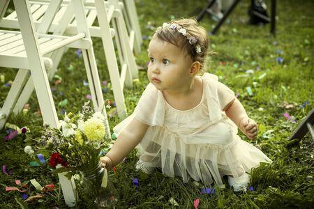 Cute little girl on a family wedding Foto de archivo - 129951866