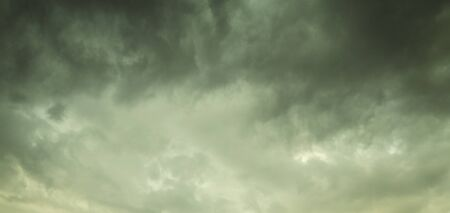 Dramatic stormy sky with dark clouds  Фото со стока