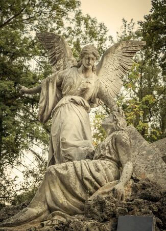 Angel stone statue on an old cemetery