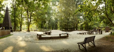 Beautiful playground with wooden equipment in a city park Фото со стока