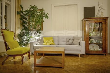 Vintage sitting room full of antique furniture Фото со стока