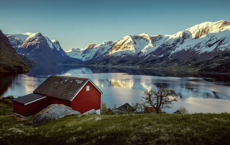 Norwegian fjord landscape in springtime Фото со стока