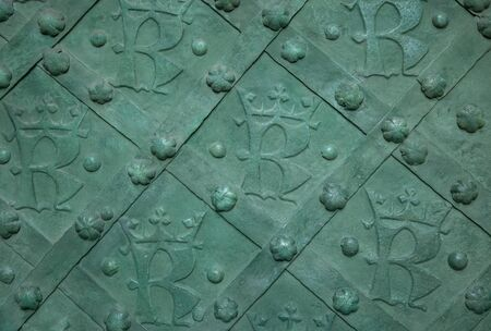 Emblem of Krakow city on a steel gate, Poland Фото со стока - 147781753