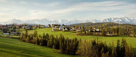 Panorama of Bukowina Tatrzanska with Tatra mountains in the background, Poland
