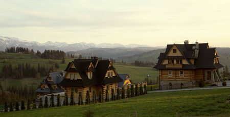 Polish traditional wooden houses in Tatra mountains, Poland Фото со стока