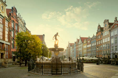 Neptune's fountain in the old town of Gdansk city, Poland
