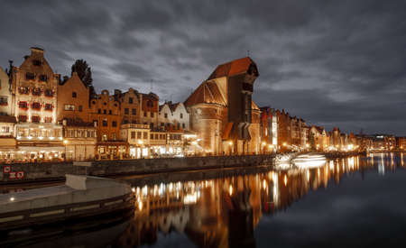 Gdansk, Poland - October 05, 2020: Old town of Gdansk city with the Crane at Motlawa river by night, Poland