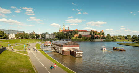 Krakow, Poland - July 20, 2013: Panorama of Wawel castle and Vistula river boulevard in Krakow city, Poland
