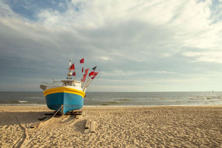 Fishing boat on the beach at Baltic sea, Poland