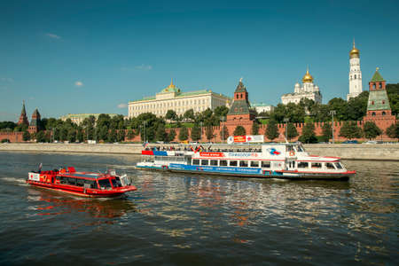 Moscow, Russia - August 31, 2017: Panorama of Moscow Kremlin with river and cruise ships in the foregraound