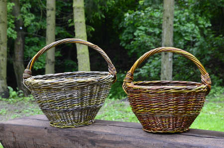 The basket which is skillfully weaved out of willow rods. Ware for collecting mushrooms, apples and vegetables.
