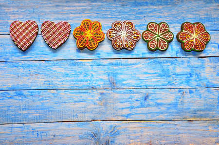 The ginger cookie lies on a wooden background of blue color. Christmas sweetness.