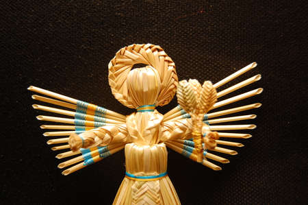 Hand-made straw products: angels, dolls, birds, buzzers, bells. Traditional straw products. Ukraine. 写真素材