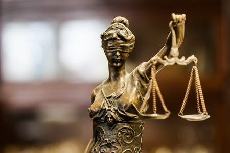 Bronze statuette of justice (focus on face) 스톡 콘텐츠