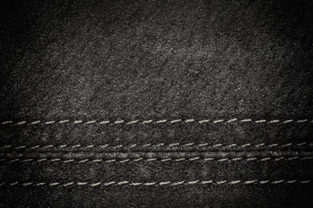 Black leather texture as background, horizontal line