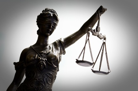 Bronze statuette of justice (focus on face) Archivio Fotografico