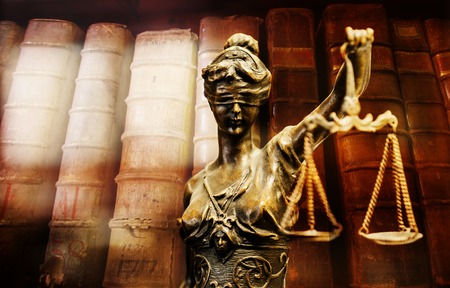 Bronze statuette of justice. Digitally assembled with blurry background. Focus on face.