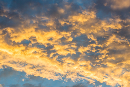 Dramatic sunset cloud with blue and gold color