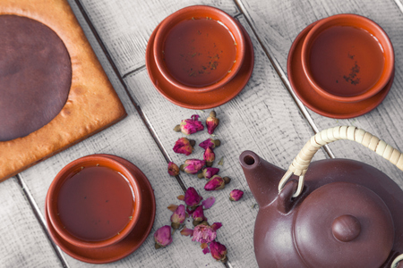 Tea ceremony, tea drinking with pottery. The concept of a cozy evening in a family restaurant Stock Photo